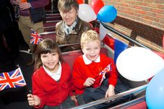 School children and the Headmistress of Riverhead Infants are ready for their ride on Lizzy's open top bus