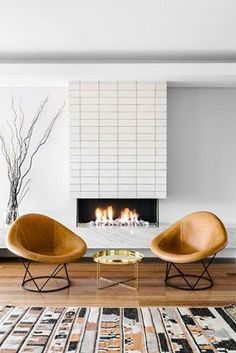 Emily Henderson Lake House Fixer Upper Mountain Home Decor Fireplace Ideas Rustic Refined Simple White Wood Stone 261 Mid Century Rustic, Décoration Mid Century, Mid Century House, Mid Century Chair, Mid Century Modern Living Room, Mid Century Modern Decor, Rocking Chair Bois, Midcentury Fireplaces, Modern Fireplaces