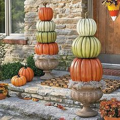 Stacked Pumpkin Topiary - easy to create by using different shapes and colors of the faux pumpkins.