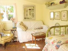 Creamy yellow walls, patchwork quilt, and a comfy couch