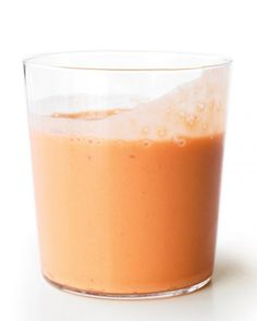 Carrot-Ginger Smoothie  • 1 banana, cut into chunks • 1 cup ice cubes • 1/2 cup bottled carrot juice • 1/2 cup yogurt • 3/4-inch piece peeled fresh ginger, coarsely chopped