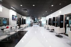 """""""The biggest challenge about our space was the long narrow unit. I strived to avoid a bowling alley look, by dividing it into areas separated by walls of mosaic tiles and tumbled stones and using accent lighting to create an open space."""""""