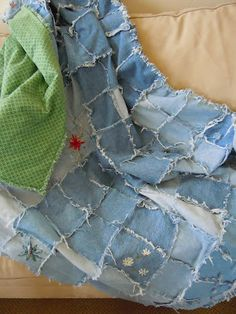 Caught my Fancy: Upcycled Jean Rag Quilt...  I am going to use all of the jean legs from all of the cut off shorts we have been making.  I have been saving the legs just waiting for something to be able to do with them!  Such a great idea!