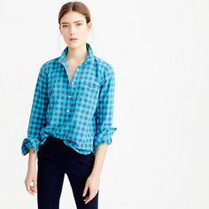 "Sure, you own a couple of gingham shirts, but you probably don't have one in a brilliant blue that makes you feel like you're on vacation even if you're really only sitting at your desk. <ul><li>Body length: 27 1/2"".</li><li>Cotton.</li><li>Long roll-up sleeves.</li><li>Chest pocket.</li><li>Machine wash.</li><li>Import.</li></ul>"