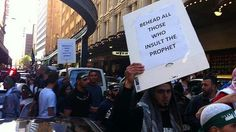 """""""Moderates"""" protest in the name of Islam, in Sydney, Australia, with a """"behead all those who insult the prophet"""" sign."""
