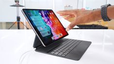 Apple Magic Keyboard: Floating iPad Pro? - YouTube Journey Songs, Marques Brownlee, Twitter S, Holiday Calendar, Tablet Cover, Apple Magic, Apple Products, Ipad Pro, Science And Technology