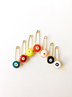 A personal favourite from my Etsy shop https://www.etsy.com/listing/290513319/5-pcs-evil-eye-pin-evil-eye-stroller-pin