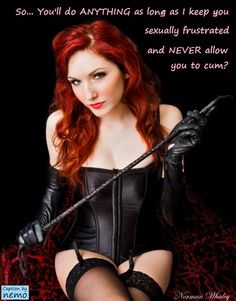 Dominatrix mistress in leather redhead for
