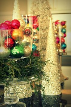 Vintage Christmas decor - old glass ornaments in a jar, glitter cone trees and some pine sprigs