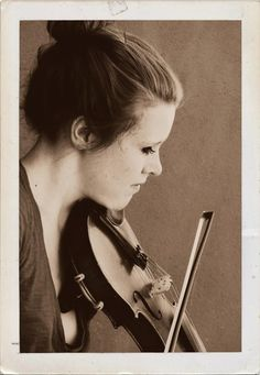 Vintage-y looking picture of myself busking at the Farmers Market, friendly vendor took this and gave it to me the next week #violin #fiddle #busker