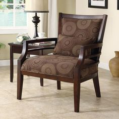 Add style and sophistication to any room with this framed chocolate-finished chair. This chair is made from durable wood and upholstered in a polyester fabric that contains soft foam fill. It features a circular pattern with ladder-style armrests.