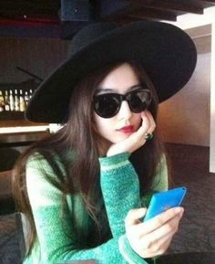 Fan Bingbing. That hat/mouth/sweater. And also b/c I don't look like that at the airport.