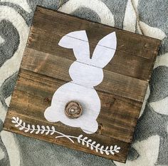 Think Spring! This adorable bunny hand-painted on a reclaimed wood plank sign…