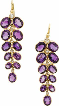 Amethyst, Diamond, Gold Earrings The earrings feature oval-shaped amethysts weighing a total of approximately 8.80 carats, enhanced by nativ...