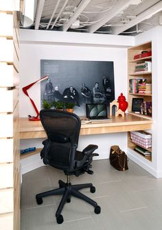 Wentworth created a cozy home office desk from birch veneer plywood in a small corner by the entrance. Built-in shelves and a floating desk give the clients plenty of space beneath.
