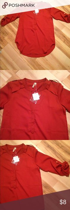 Women's blouse size medium shirt Brand new with tags rusty colored women's shirt! This shirt is a rusty color and has the cutest sleeves- the blouse is a soft/silky material. It comes with a extra button just in case one were to ever fall off but I buy this brand all the time and never have to use the extra buttons. It is longer in the back and front and a little shorter on the sides! Super cute with leggings, dress pants, or jeans with boots! Size medium! Tops Blouses
