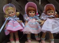 Three versions of the 1951 Glad #42 Ginny.  Center doll is a repro Ginny, the other two are vintage strung Ginny dolls in outfits made by creative seamstresses.