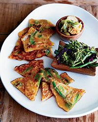 Kimchi Pancakes There are countless varieties of the chewy Korean pancakes called jun that can be served as an appetizer or side dish. For this version, chef Joshua Walker flavors the batter with both kimchi liquid and a little pungent black bean sauce. Spicy Recipes, Wine Recipes, Asian Recipes, Great Recipes, Vegetarian Recipes, Cooking Recipes, Favorite Recipes, Ethnic Recipes, Asian Foods