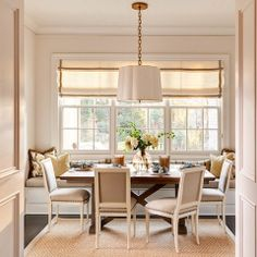 Banquette and tailored roman shade