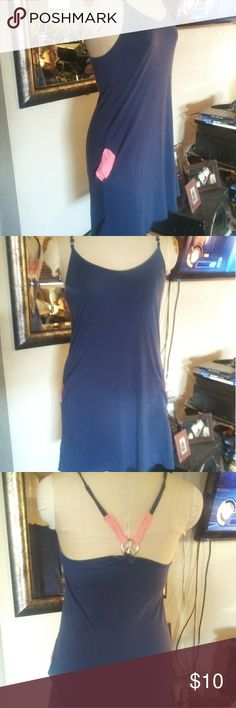 Olsenboye size medium cute blue dress Really cute Blue dress. Size is a medium. Has really cute pink pockets and peace sign in back with pink straps in back. See picture. Has really small spot on dress. Unsure if can come out. Shown in last picture. Dress measures 16 inches flat from pit to pit. Olsenboye Dresses Mini