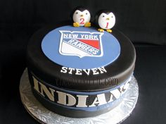 Hockey puck cake for fan of New York Rangers, plays Lacrosse for Catawba Indians and loves penguins. By thecakeattic.com in Salisbury, NC www.facebook.com/thecakeattic