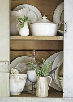 ironstone.  Incorporate sprigs of greenery and random glass containers with contents (instead of being empty)  adds depth.