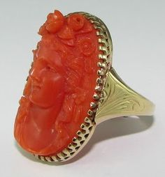 Carved coral cameo ring