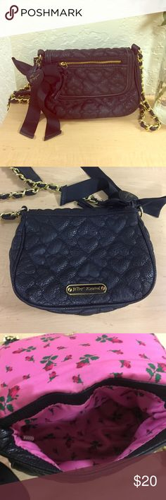 Betsey Johnson Across The Shoulder Black Purse Small little black purse, PERFECT for going out. Quilted heart pattern on the outside with small pocket on the top. Large enough to fit phone, keys, small wallet and a couple make up items. Gold hardware Betsey Johnson Bags Shoulder Bags