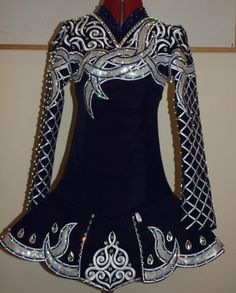 Feison Forward Diore Irish dace solo dress. Like the placement of appliques on shoulders/sleeves.
