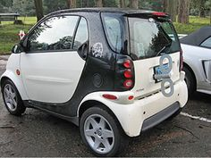 I love the sense of humor that the owners of the wind-up Smart Cars must have. How fun it is to drive behind one of these!