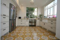 Beautiful old style floors in a new kitchen that are typically found in older buildings in Israel and throughout the Mediterranean.