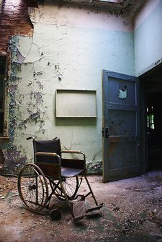 Pennhurst A view of an abandoned wheelchair left behind on the second-floor. Inside a room with a sky-light. Inside Union Hall. At the former Pennhurst State School & Hospital.