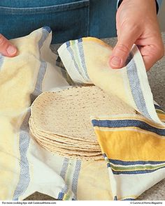 Here's an easy way to keep your wraps from crumbling, and keep the ingredients where they belong — in one place! To reheat tortillas, cover them with a damp cloth towel, then wrap them in aluminum foil and pop them in a 250° oven for 10–15 minutes. They'll come out warm and pliable, and won't tear or fall apart! | Cuisine at Home