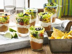 Mini 7 Layer Dips Try this new twist on the traditional Seven Layer Dip: a new mini size! Dip Recipes, Mexican Food Recipes, Cooking Recipes, Ethnic Recipes, Party Recipes, Mexican Dishes, Recipies, Party Snacks, Mexican Snacks