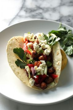 Greek Salad Chickpea Tacos by Baker by Nature