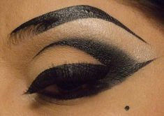 you outline first with liquid eyeliner, then add black shadow to blend. Apply fake lashes and Viola!