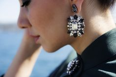 @Style Boom shows how to rock statement earrings with Swarovski by Shourouk pierced earrings with a lady-like 40's look. Photo courtesy of  www.styleboom.net
