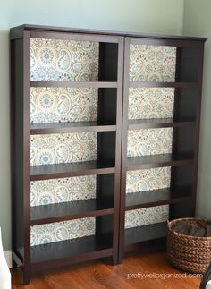 How to decoupage a bookcase with fabric.  For big double bookcases!