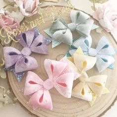 "Glitter and velvet loop hair bow Material: Made with velvet fabric backed with felt and a chunky glitter fabric Choice of colours:  Pink  Blue  Lemon  Mint  Lilac Size: The bow measures just over 3"" Clip or headband:  An alligator clip lined with ribbon.  A THIN 3mm soft"