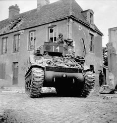 A Sherman tank of the Sherbrooke Fusiliers Regiment, Caen, France, 11 July Maple Leaf insignia. Pin by Paolo Marzioli D Day Normandy, Normandy Beach, Canadian Army, British Army, Ww2 Photos, Ww2 Pictures, Sherman Tank, Military Armor, Ww2 Tanks