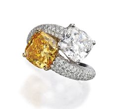 Fancy Vivid Yellow-Orange Diamond and White Diamond Ring