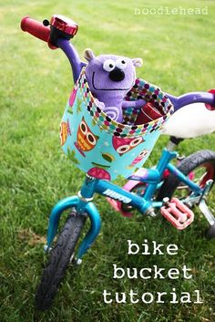 "Bicycle bucket tutorial. This is so clever, little ones always want to take ""play friend"" along on bike rides, but where to put them? The solution, make one of these cute buckets."