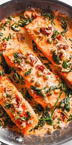 Pan-Seared Creamy Tuscan Salmon with Garlic, Spinach, Artichokes, Sun-Dried Tomatoes, and Capers. This recipe features the best white cream sauce for salmon! Ready in 30 minutes! If you're looking for a family-friendly dinner recipe to Baked Salmon Recipes, Seafood Recipes, Cooking Recipes, Healthy Recipes, Salmon Spinach Recipes, Capers Recipes, Fresh Fish Recipes, Cooking Tv, Sushi Recipes