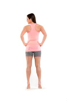 #Shefit form fitting racer-back T-Fit Tank top:  The extended long back hits below the hip and allows you to decide how much booty to show. $35 CLICK HERE to buy http://shop.shefit.com/collections/all-products/products/t-fit-tank #FitnessOutfits #GymOutfits