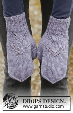 """Set consists of: Knitted DROPS hat, poncho and mittens with lace pattern and rib in """"Merino Extra Fine"""". ~ DROPS Design"""