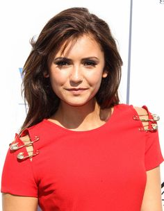 Nina Dobrev Layered Cut - As if we weren't already jealous of Nina's tresses, her choppy layers made us just swoon.