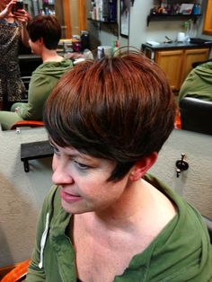 Red Copper-Brown Color with a hint of Emerald Green highlights in the Bangs. Used a #4 clipper guard on the back lower part of the head.