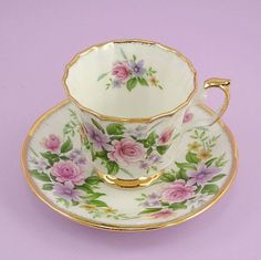 Vintage Tea Cup and Saucer Bone China England Queens China English Charm Staffordshire Pink Roses Clematis Primrose. Cup And Saucer Set, Tea Cup Saucer, Keramik Vase, Cuppa Tea, Vintage Cups, Vintage China, Vintage Dishes, Antique China, Teapots And Cups