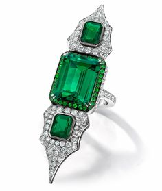 http://rubies.work/0696-sapphire-ring/ Anna Hu Haute Joaillerie emerald ring from the Modern Art Deco collection in white gold set with three Colombian emeralds, round brilliant-cut white diamonds and tsavorites.