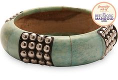 A wood bracelet with turquoise enamel from the set of The Best Exotic Marigold Hotel movie.